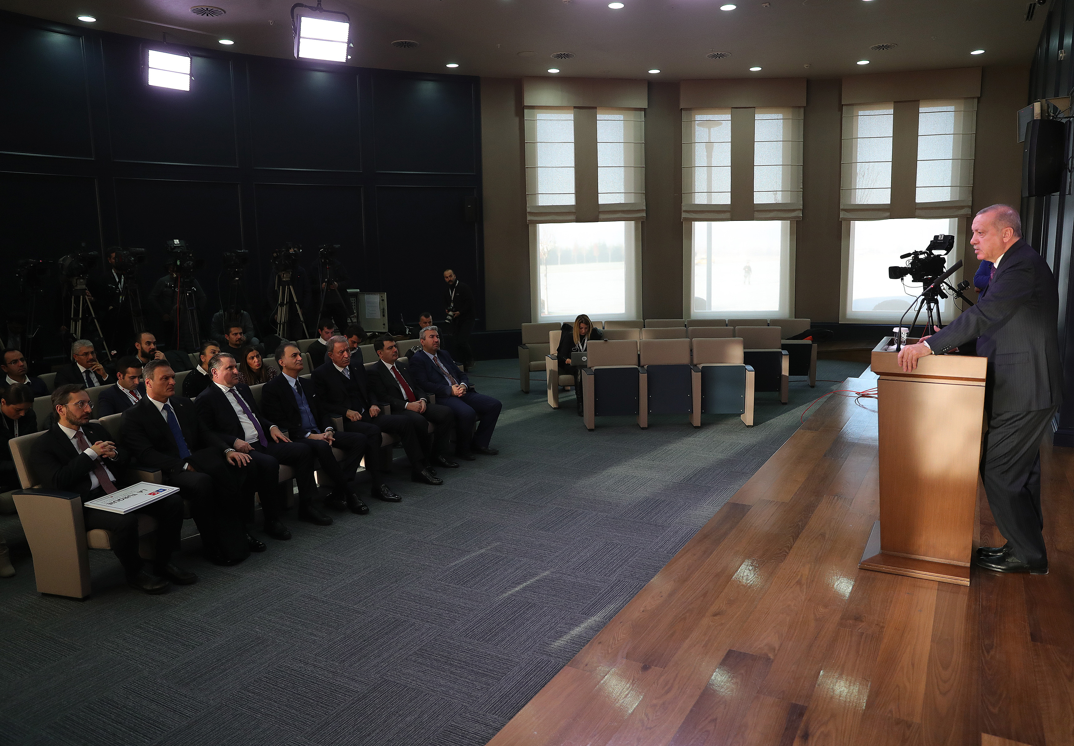 President Erdoğan addresses media persons before departing to London for a NATO summit